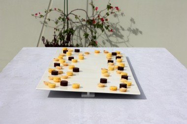 Communal tipping plate serving small citrus desserts