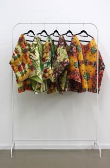 Untitled (serviette shirts). Printed paper serviettes and glue