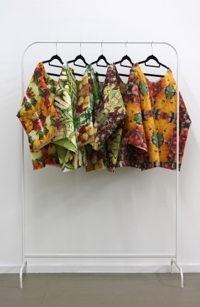 Untitled (serviette shirts). Printed paper serviettes and glue