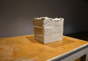 Kernel. Forton cast of butter sculpture on dining/studio table. 40x40x35cm