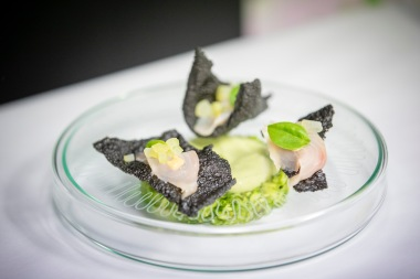 Laser etched glass petri dish, served with Ceviche of cobia, pickled cucumber, squid ink cracker